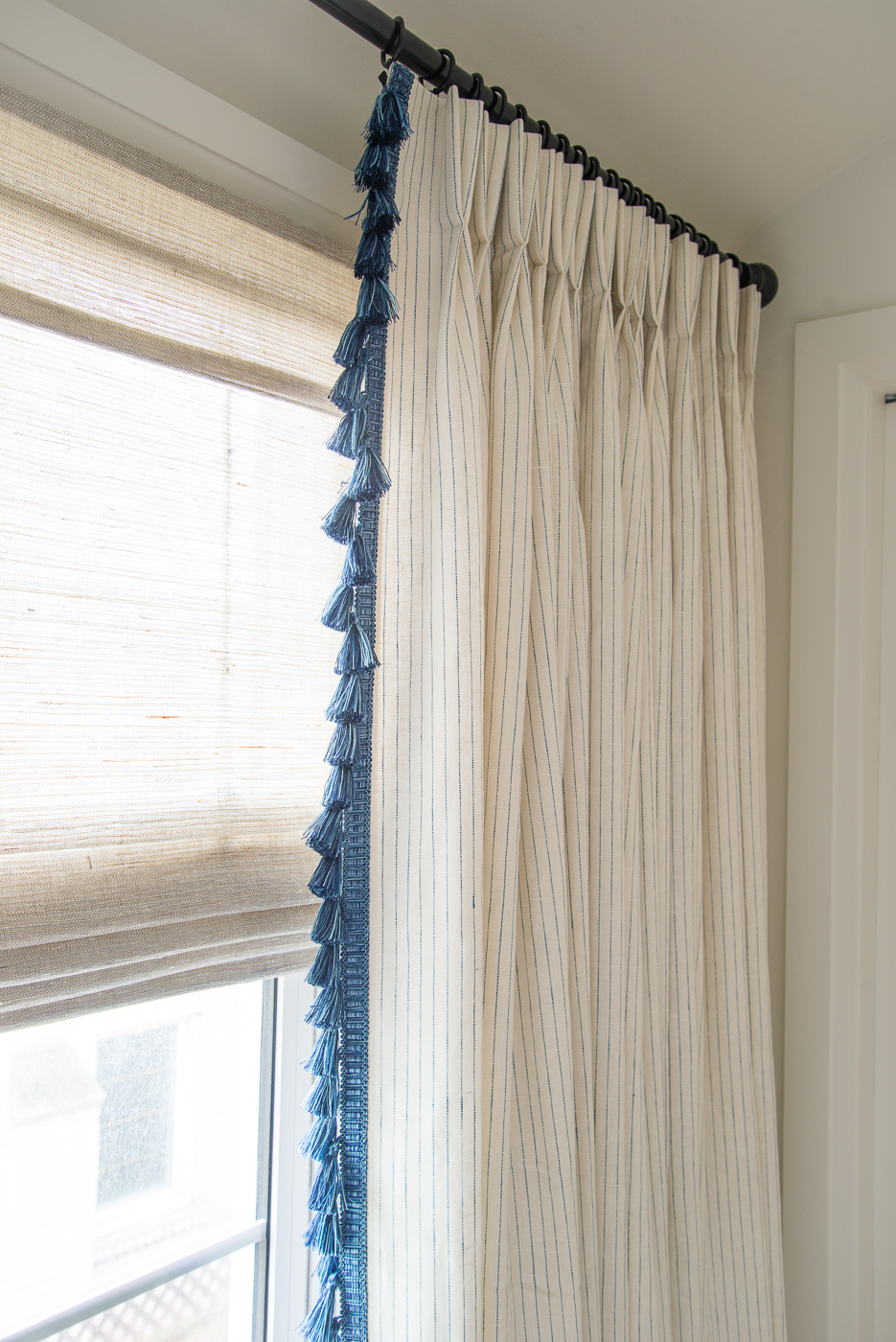 coastal woven blind with drapery panel, drapery panel with tassel trim