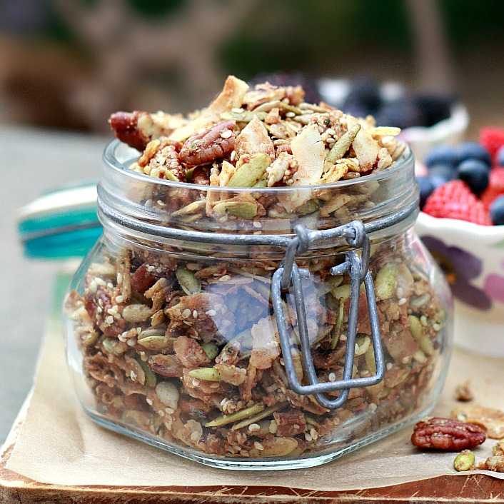 A jar of homemade grain-free granola with seeds, nuts, and coconut oil. What a great breakfast or edible gift idea.