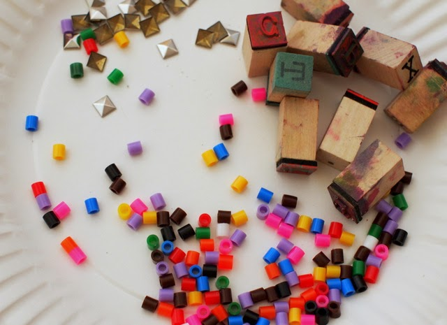 Beads and stamps to put in your sand dough