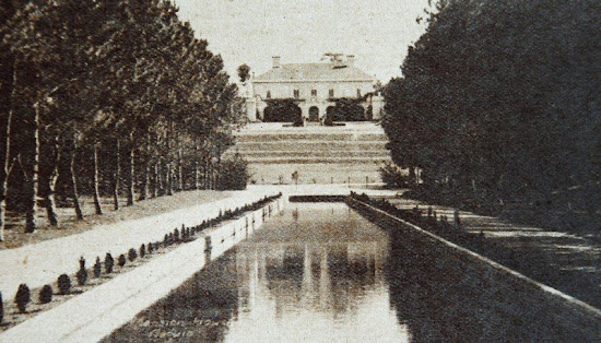 Photo of Mansion House taken at the reflecting pool of Wright Park