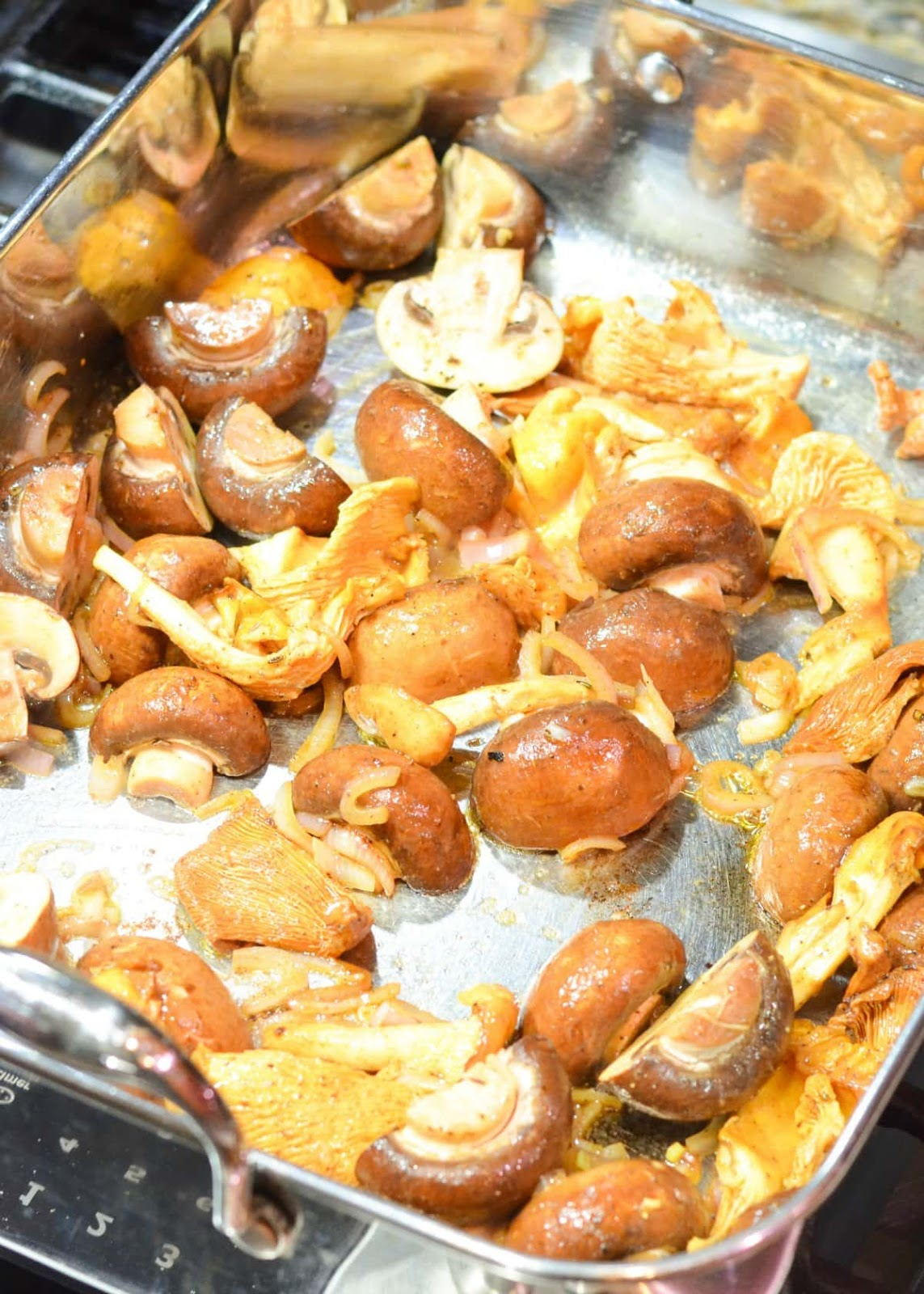 Cremini and Chanterelle Mushrooms in a roasting pan with shallots being sautéed.