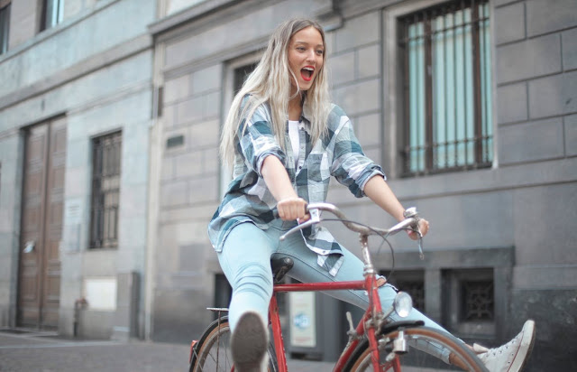 A healthy woman riding a bike