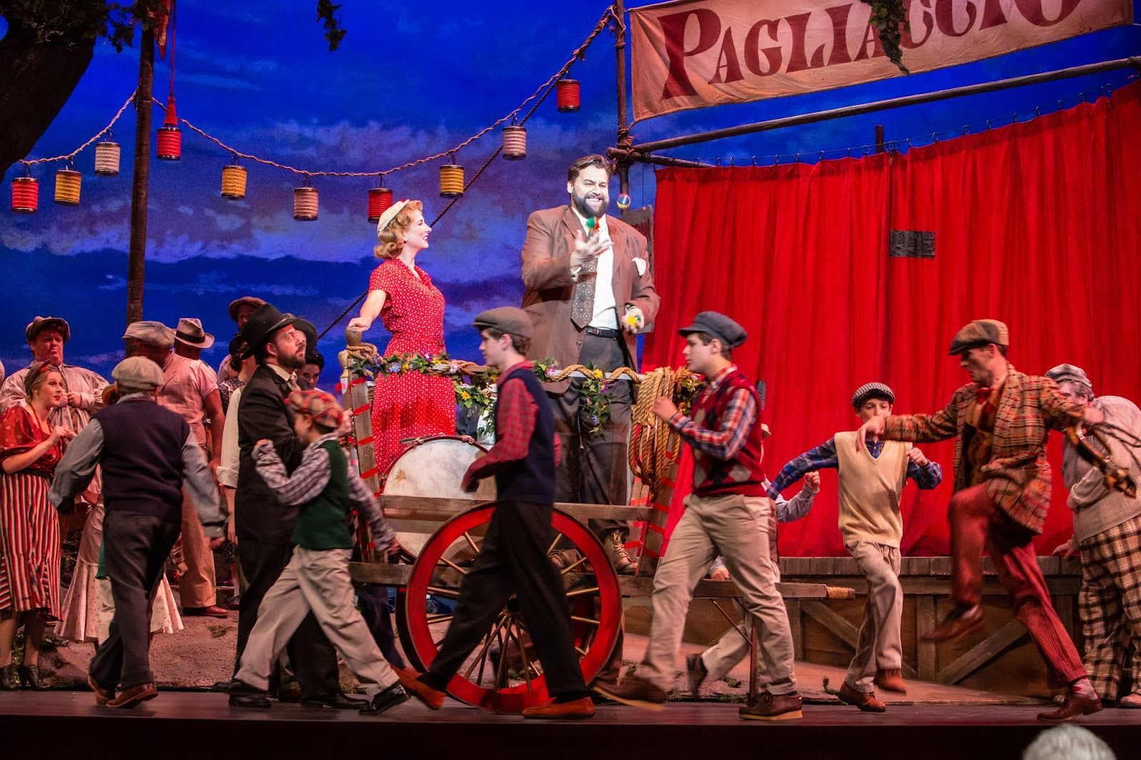 IN REVIEW: soprano SUZANNE KANTORSKI as Nedda (center left), tenor BRANDON SCOTT RUSSELL as Canio (center right), and the cast of Greensboro Opera's November 2019 production of Ruggero Leoncavallo's PAGLIACCI [Photograph by Becky VanderVeen, © by VanderVeen Photography & Greensboro Opera]