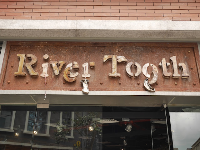 "partially destroyed ""River Tooth"" sign in Zhuhai"