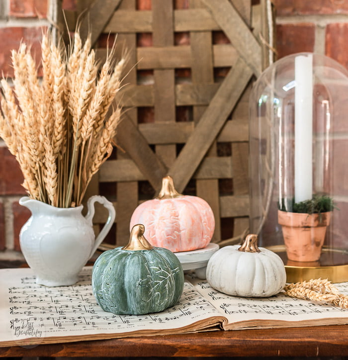 pumpkins transformed with white wax and gold stems