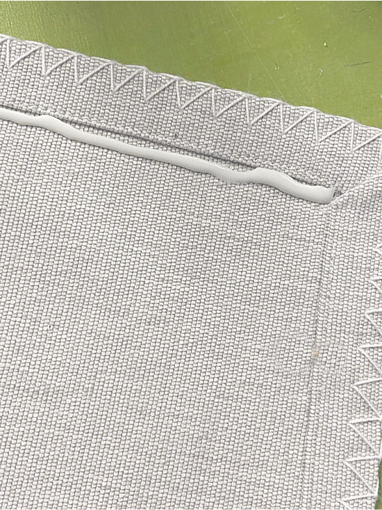 Fabric hot glue on a place mat