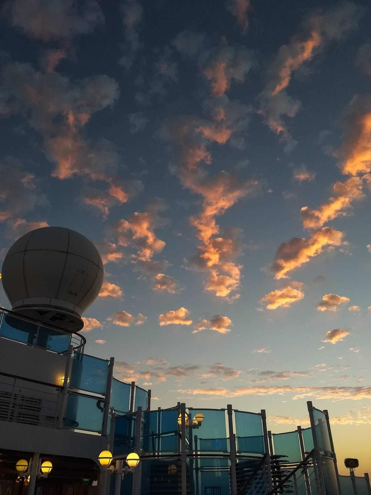A view of sunset clouds above the Sapphire Princess cruise ship.