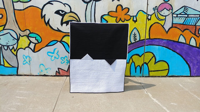 Modern black and white quilt with giant prairie points