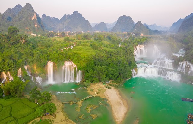 Ban Gioc waterfall majestically turns into a dreamy white silk stretching to the autumn