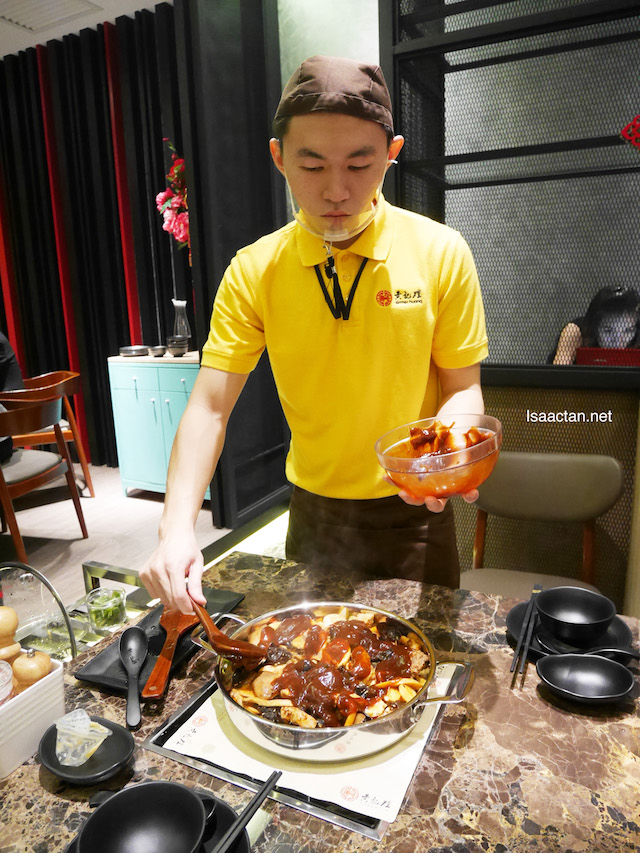 The waiter preparing out Three Sauce Simmer Pot @ Pavilion Elite, Kuala Lumpur