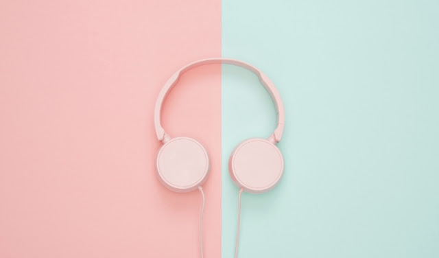Pink headphones on pink and blue background