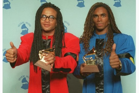 Rob Pilatus, left, and Fab Morvan of Milli Vanilli give the thumbs-up as they display their Grammys after being presented with the 1989 best new artist ...