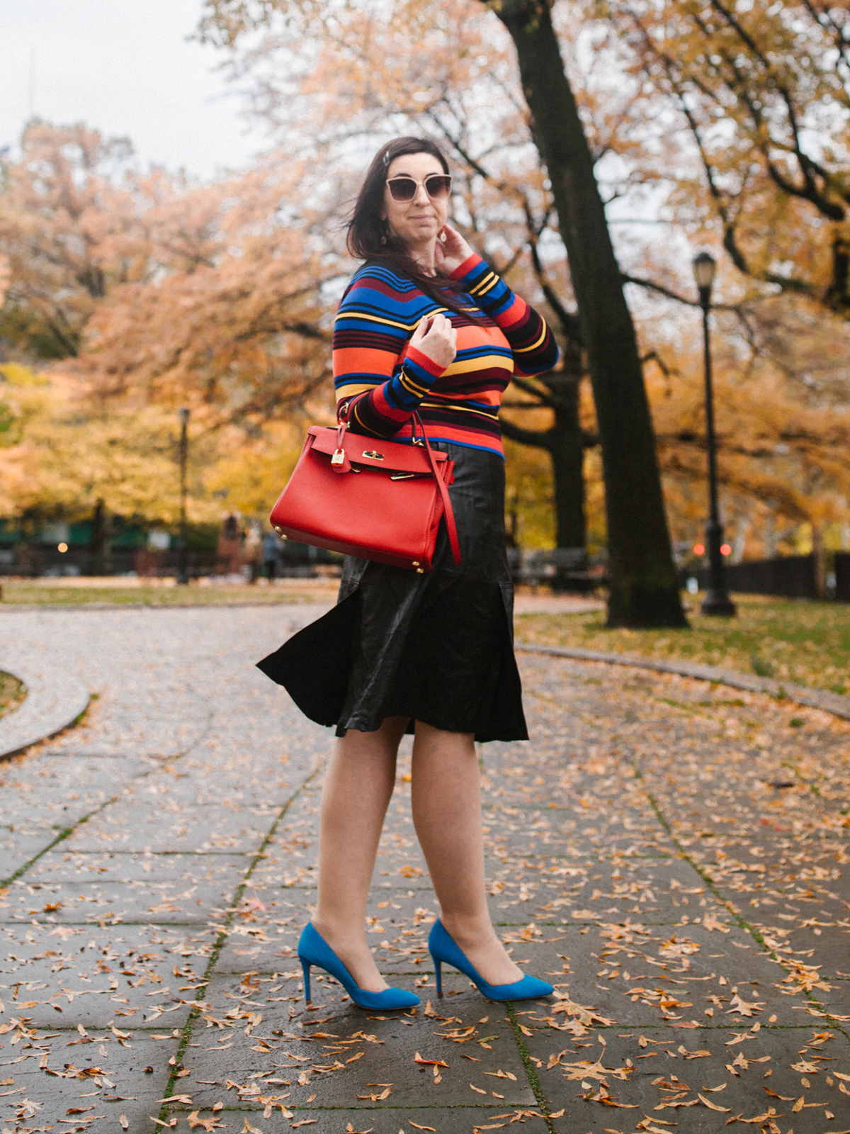 OOTD: The perfection of the striped sweater for Fall and Winter featuring the Express Striped Bateau Neck Fitted Sweater, Banana Republic Leather Midi Skirt, Hermès Kelly Bag in red, Loeffler Randall Pari Pump, Express Rimmed Square Frame Sunglasses and Express Star Flower Open Cubic Zirconia Pull Through Earrings :: Effortlessly with Roxy
