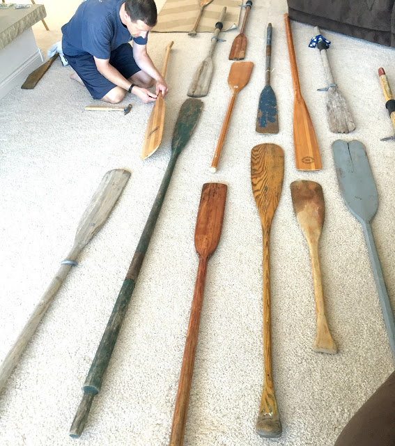 Creating an oar wall. One paddle at a time.