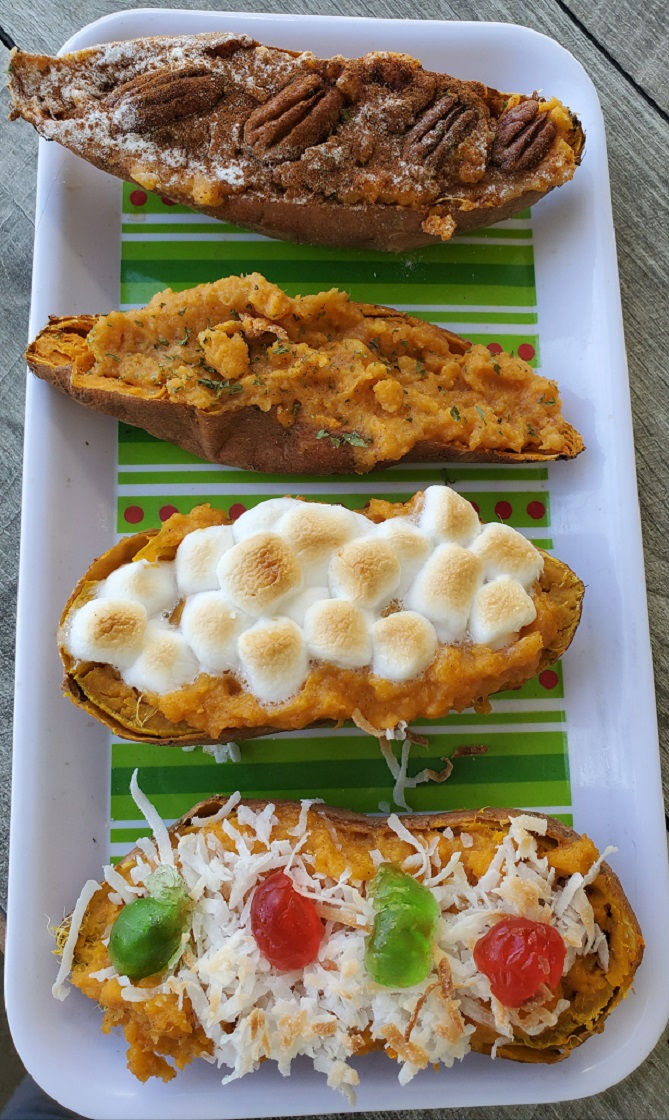 these are stuffed sweet potatoes twice baked with various topping like pecans, marshmallows and red cherries with coconut