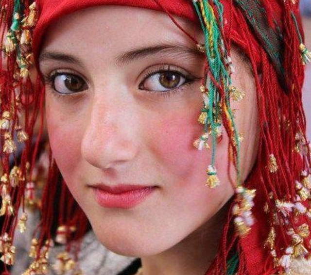 A Berber girl from Souss region, wearing a traditional red scarf