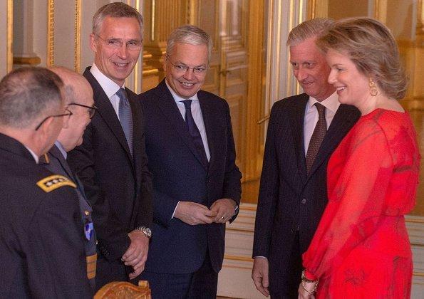 Queen Mathilde wore Natan silk print dress. Queen Mathilde wore a red silk midi dress by Natan. gold earrings