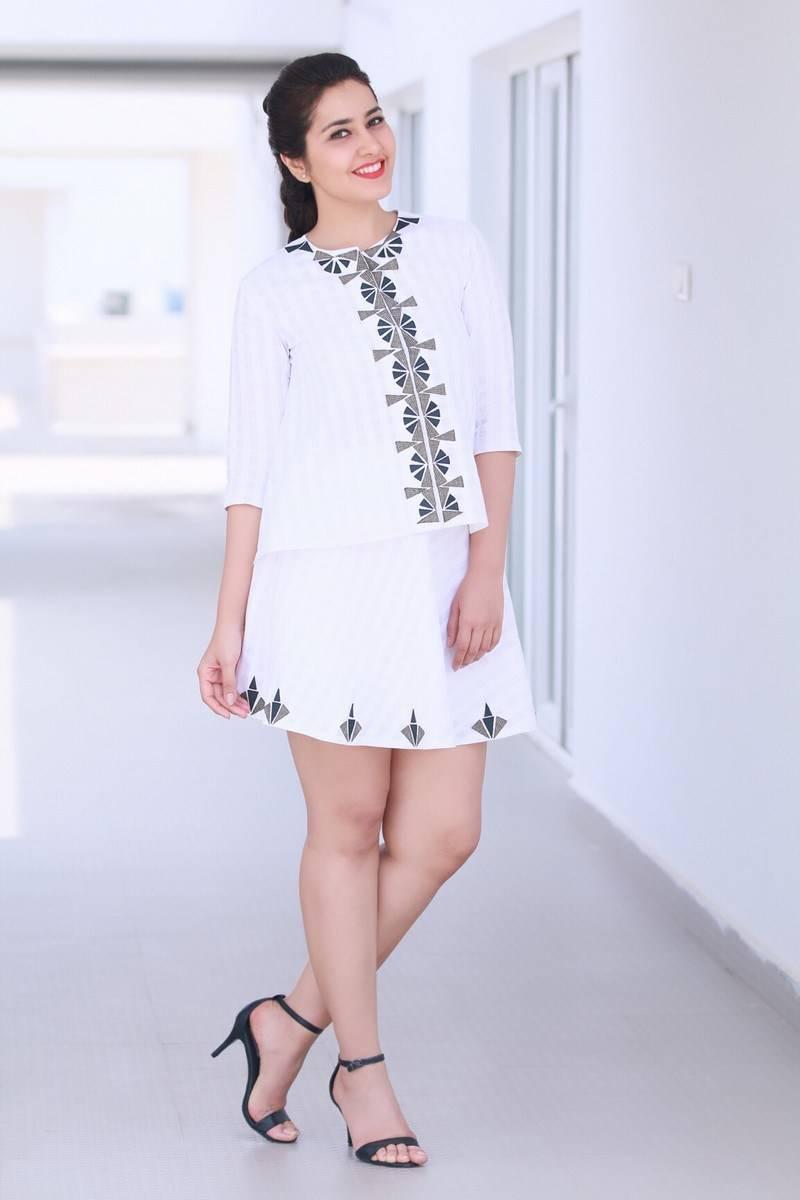 Rashi Khanna Cross Legs Show Stills In White Mini Skirt ❤