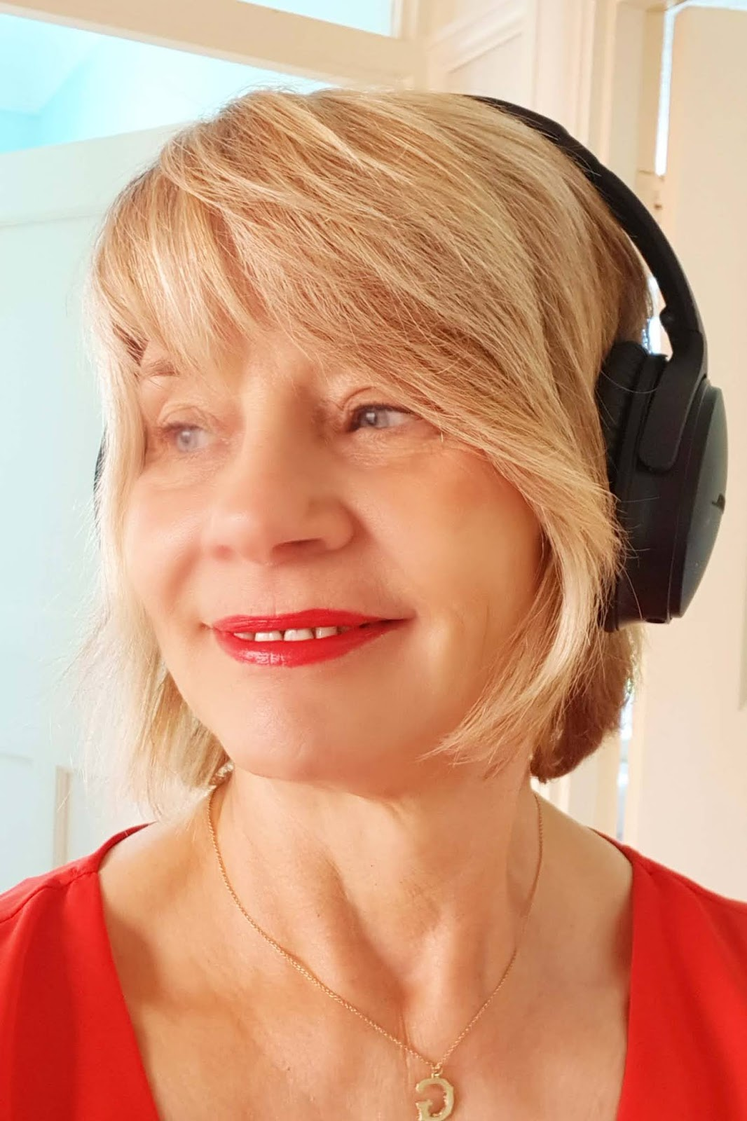 Gail Hanlon and headphones for Friday Favourites, podcast and TV reviews, in blog Is This Mutton