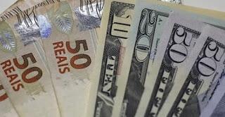 Bolsa cai, e dólar bate R$ 5,70 após governo elevar imposto de bancos