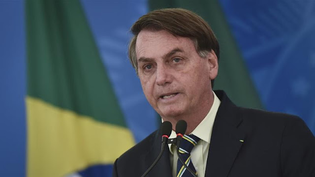 Brazilian president Jair Bolsonaro on a live televison after tested positive of COVID-19 photos download