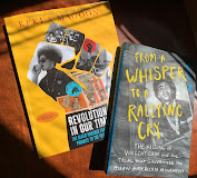 Two books on a table together. One is Revolution in Our Time and the other is From a Whisper to a Rallying Cry