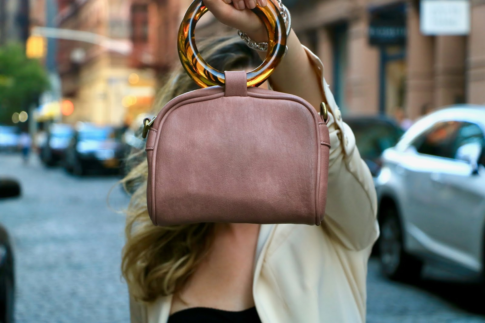 Nyc fashion blogger Kathleen Harper wearing an Anthropologie top handle purse.