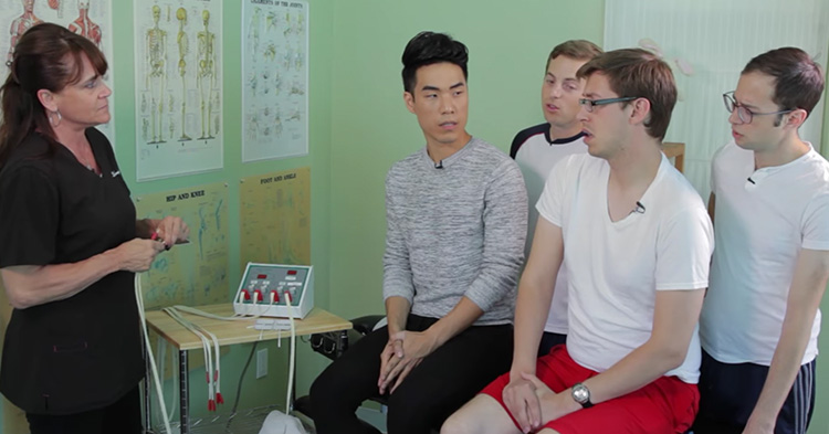 The medical staff explaining what will happen when the guys tries the simulator.