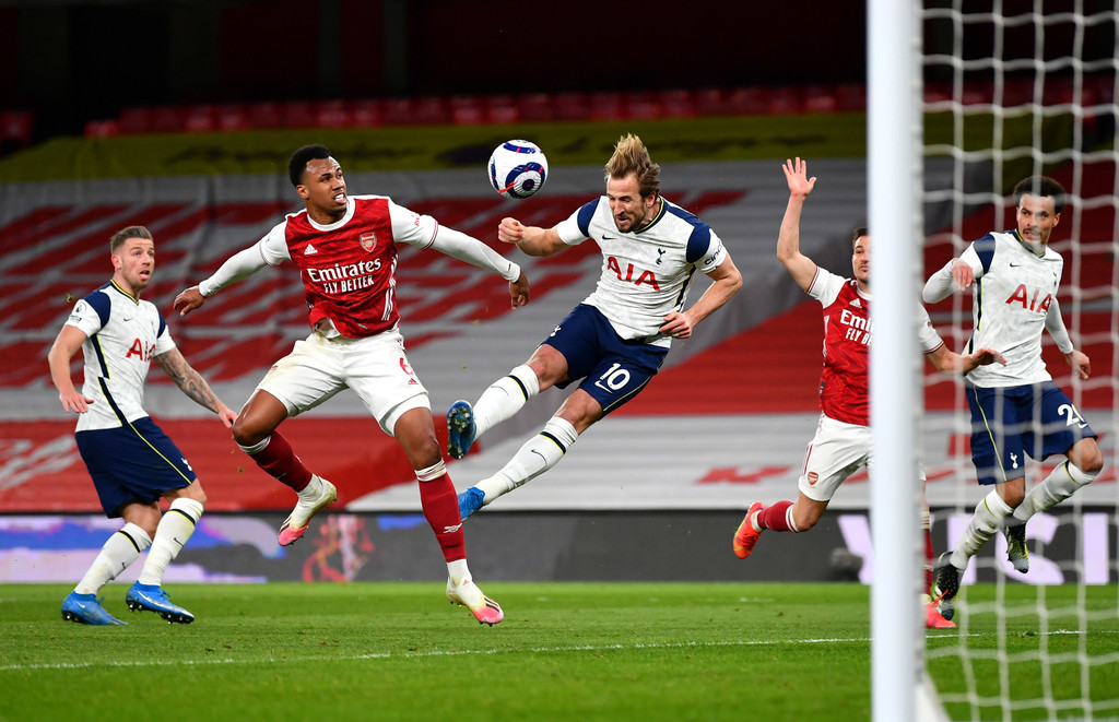 Harry Kane of Tottenham Hotspur scores their side's second goal whilst under pressure from Gabriel Magalhaes of Arsenal which is disallowed for offside during the Premier League match between Arsenal and Tottenham Hotspur at Emirates Stadium on March 14, 2021 in London, England