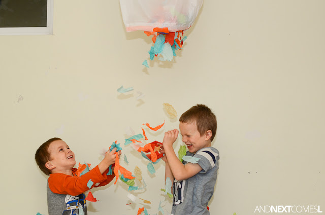 Make confetti fall from a ceiling with this DIY confetti drop for kids