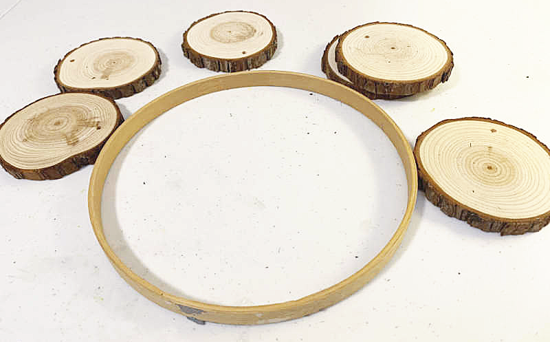 wood slice and embroidery hoop supplies for a wreath