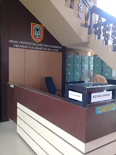 meja informasi di perpustakaan provinsi kalimantan selatan