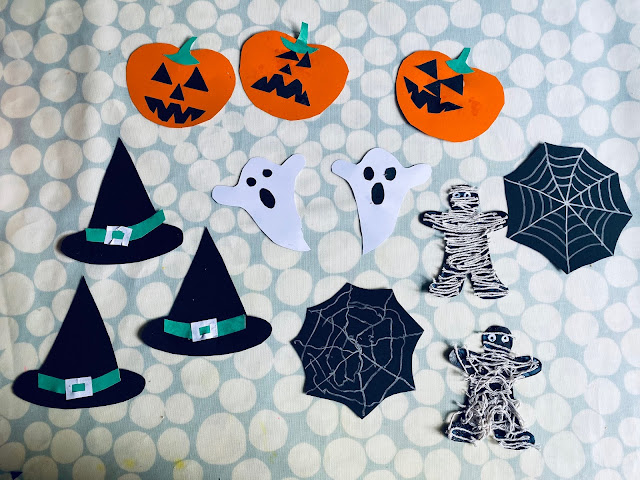 3 witches hats, 3 pumpkins, 2 ghosts, 2 spiders webs and 2 mummies. Some were obviously made my an adult, others were made by a preschooler