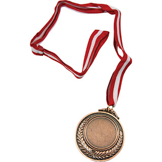 Yuxuda Bürünc Medal Görmek