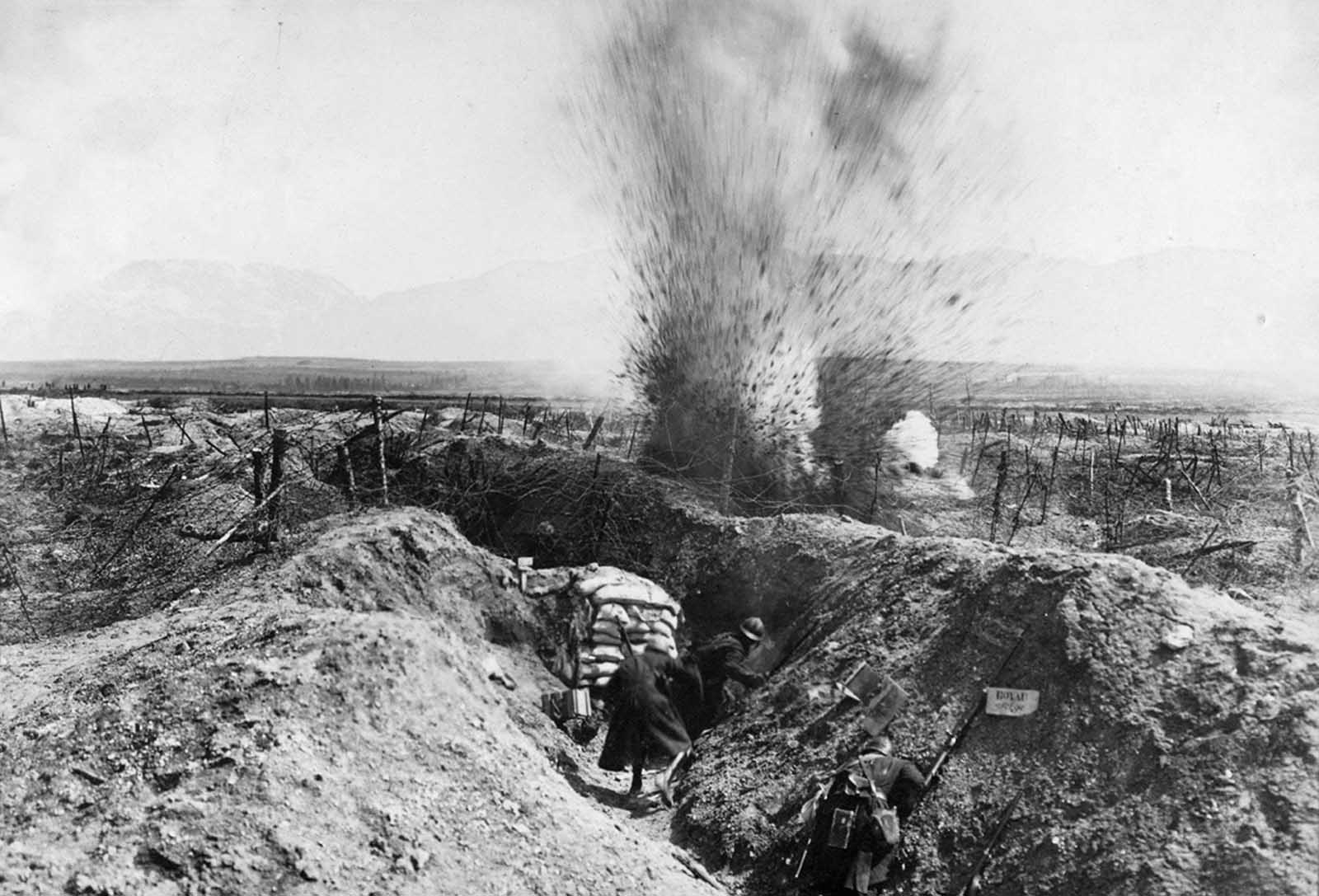 An explosion near trenches dug into the grounds of Fort de la Pompelle, near Reims, France.