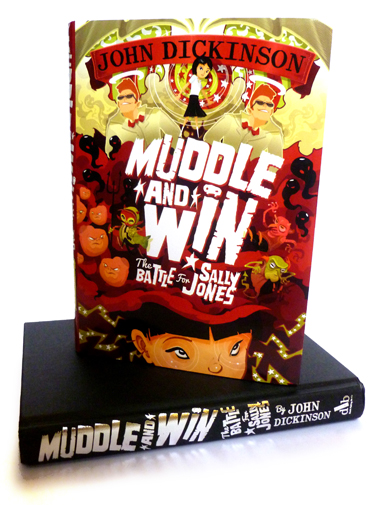 Muddle and Win - Photo of one book standing on top of another one that doesn't have it's dust cover on