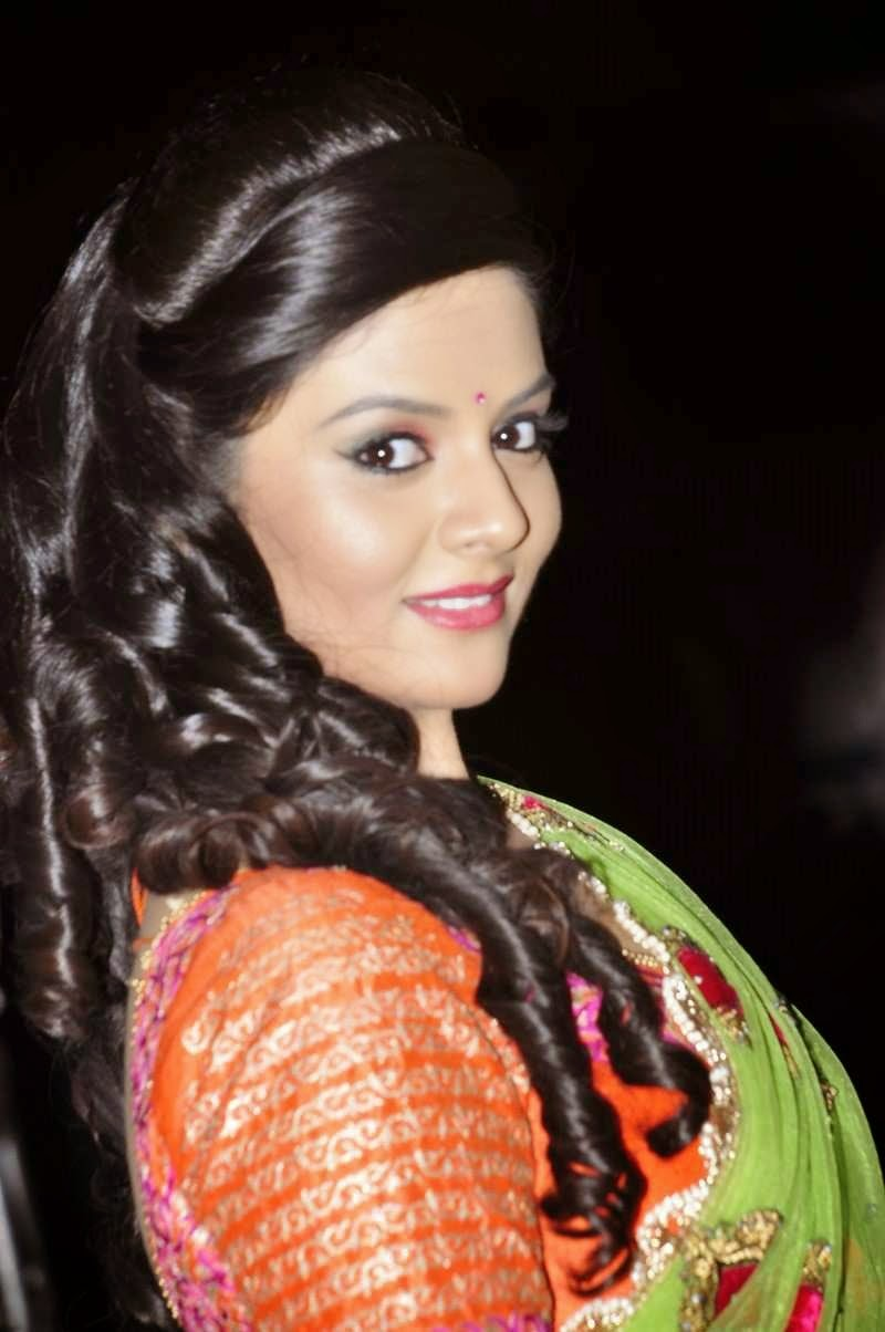 Sree mukhi Stills In Green Half Saree