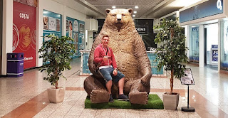 Sitting on a sitting Grizzly Bear - number 2 on the Lowry Outlet's Bear Hunt