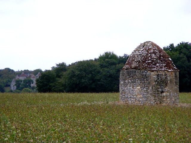 Chateau de Forges in the background, vine hut in the foreground, Indre, France. Photo by Loire Valley Time Travel.