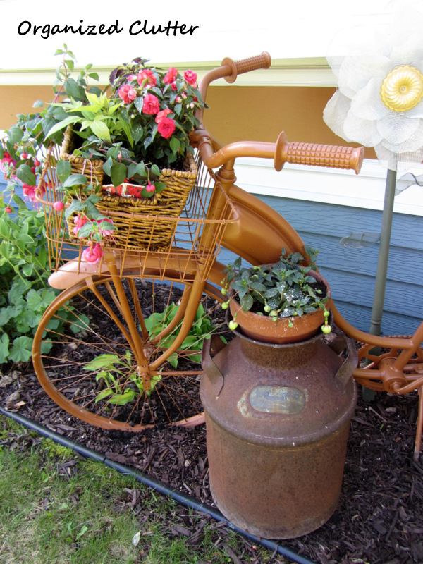 Newly Planted Annuals in Vintage Bike Basket www.organizedclutterqueen.blogspot.com