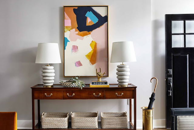 Jenny Prinn artwork and Kelly Wearstler stacked table lamps in entryway