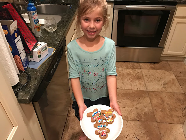 Sienna shows off her gingerbread men.