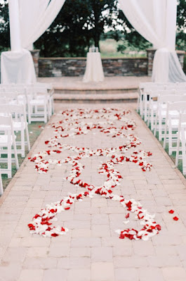 red and white flower petals on ceremony ground