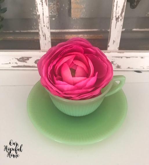 jadeite tea cup causer pink ranunculus stem