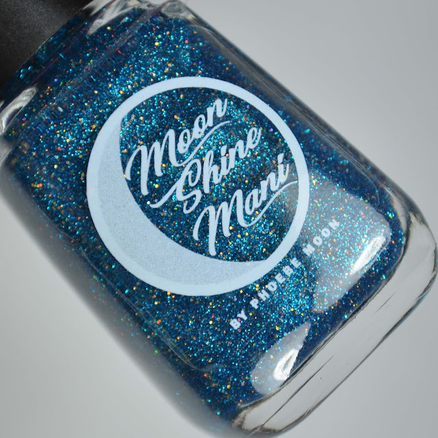 blue micro glitter and gold holographic micro glitter nail polish in a bottle
