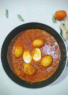 Prepared egg curry recipe with tomato onion gravy in a pan