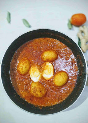 Prepared egg curry recipe with tomato onion gravy in a pan