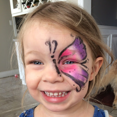toddler with butterfly painted face
