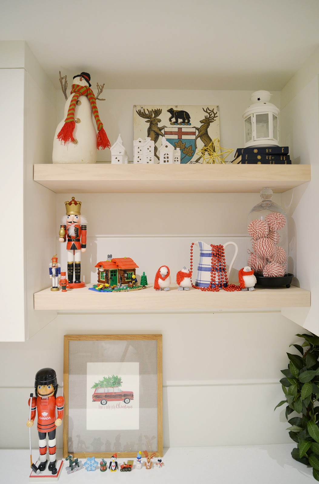 open shelving, wood shelves with whimsical Christmas decorations