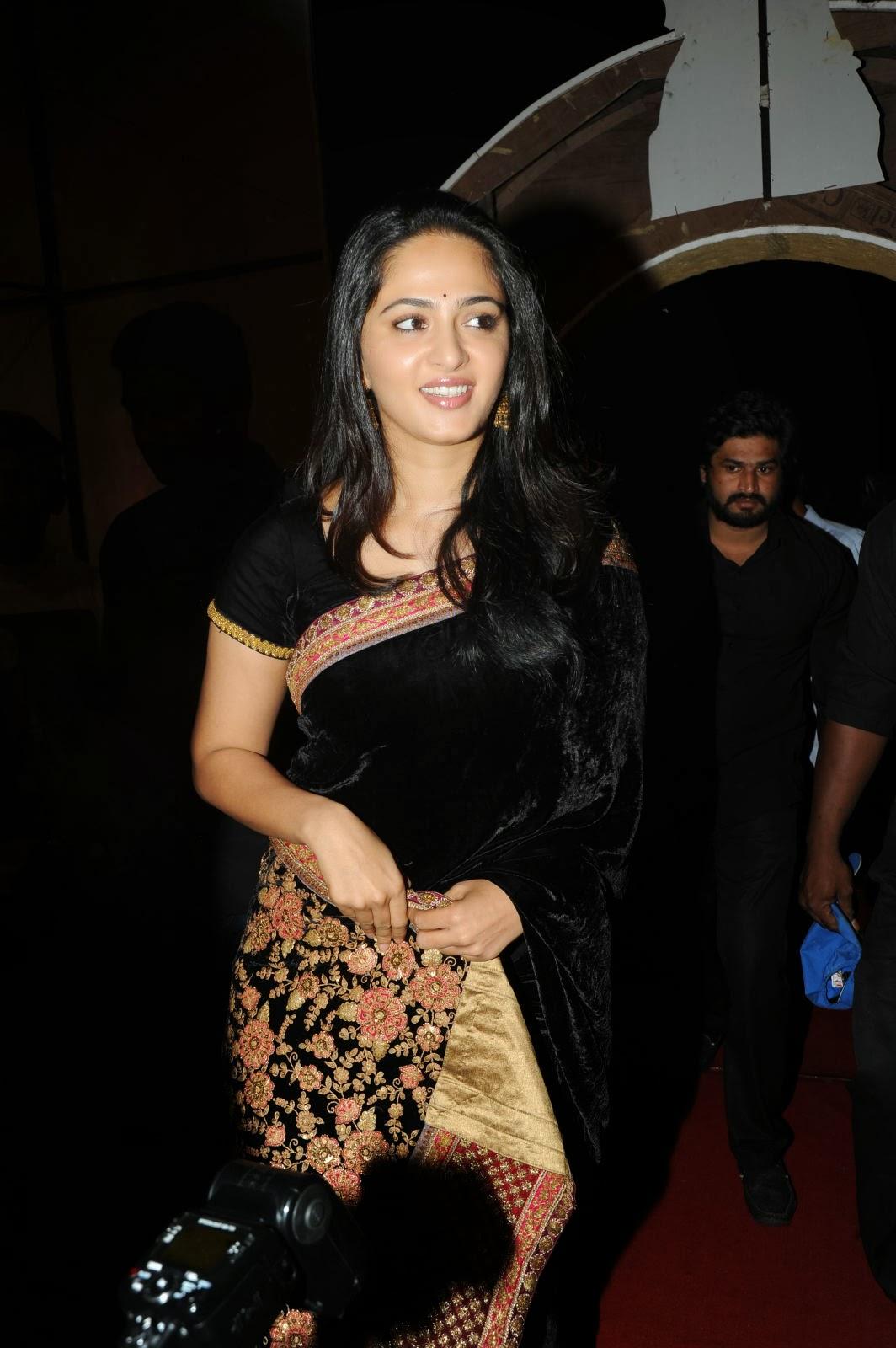 Enticing Anushka Shetty in black saree at varna audio launch